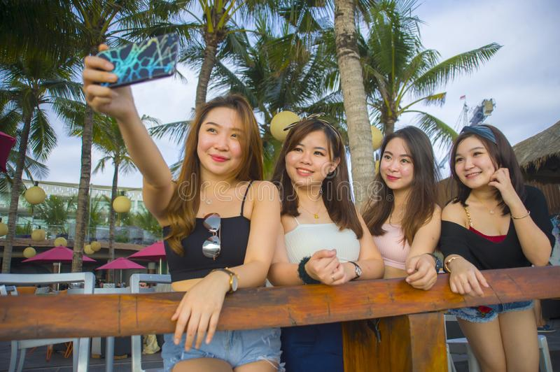 Group with young happy and attractive Asian Chinese and Korean women hanging out , girlfriends enjoying holidays trip in tropical royalty free stock photography