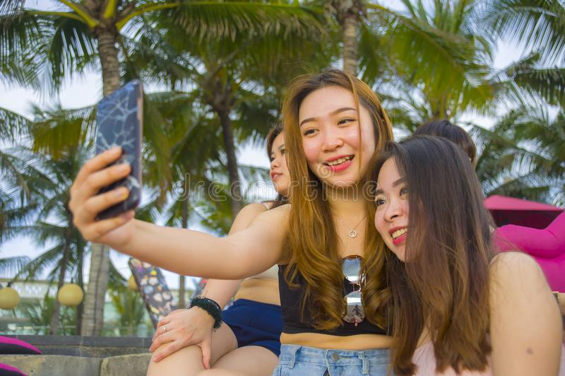 Group with young happy and attractive Asian Chinese and Korean women hanging out , girlfriends enjoying holidays trip in tropical royalty free stock image