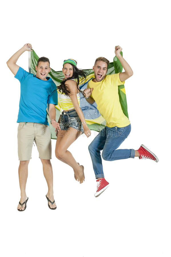Group of young happy sport supporters with Brazil flag. Group of young happy sport supporters jumping with Brazil flag stock photography
