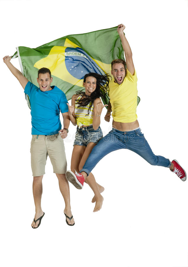 Group of young happy sport supporters with Brazil flag. Group of young happy sport supporters jumping with Brazil flag stock image