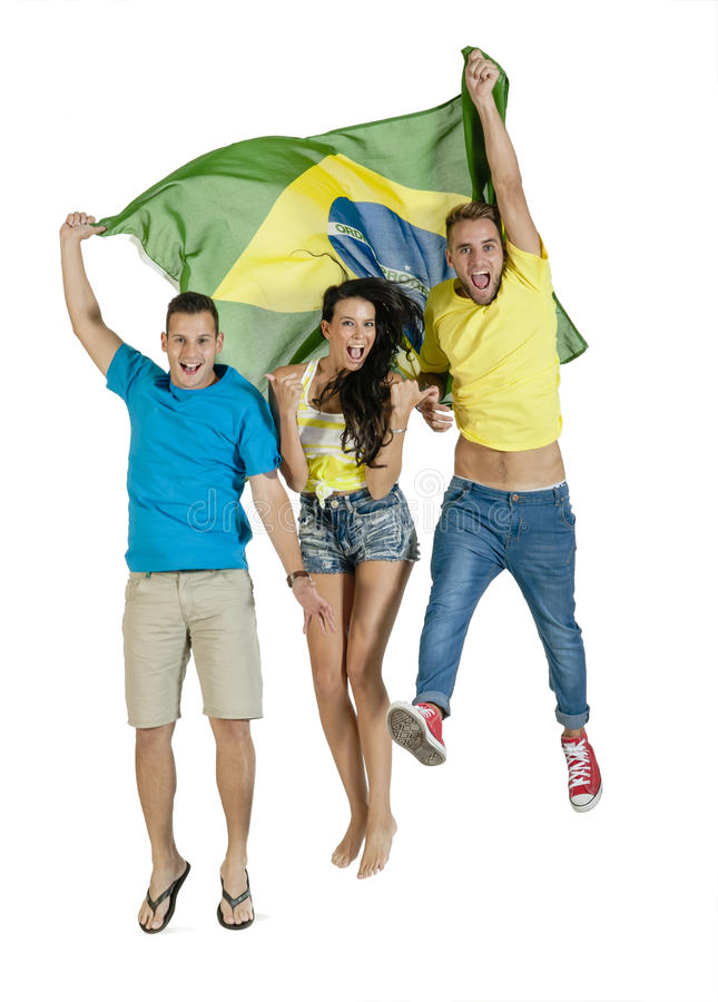 Group of young happy sport supporters with Brazil flag. Group of young happy sport supporters jumping with Brazil flag stock photos
