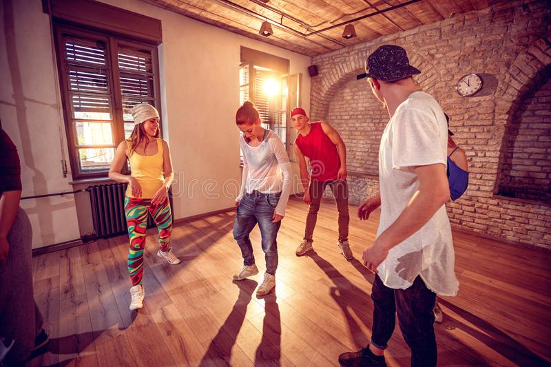 Young hip hop dancers dancing in the studio. Sport, dancing and. Group of young hip hop dancers dancing in the studio. Sport, dancing and urban culture concept royalty free stock photo