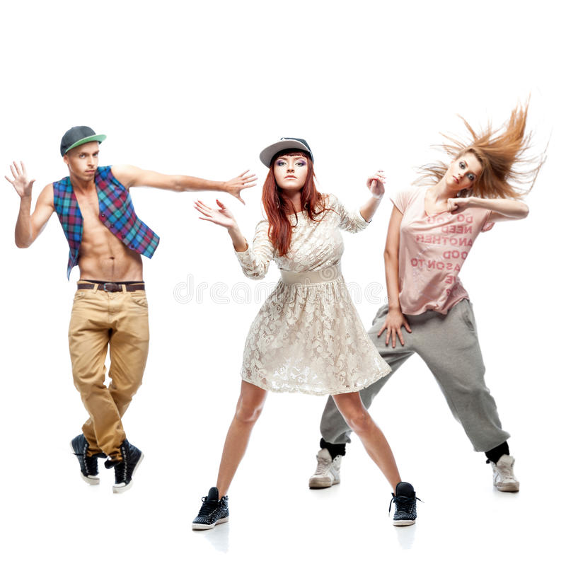 Group of young hip hop dancers on white background. Group of young hip hop dancers isolated on white background stock image