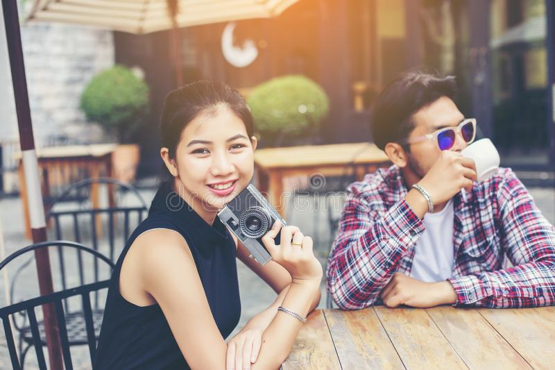 Group of young hipster sitting in a cafe,Young cheerful friends having fun while take time together, Holiday freedom enjoy royalty free stock photos