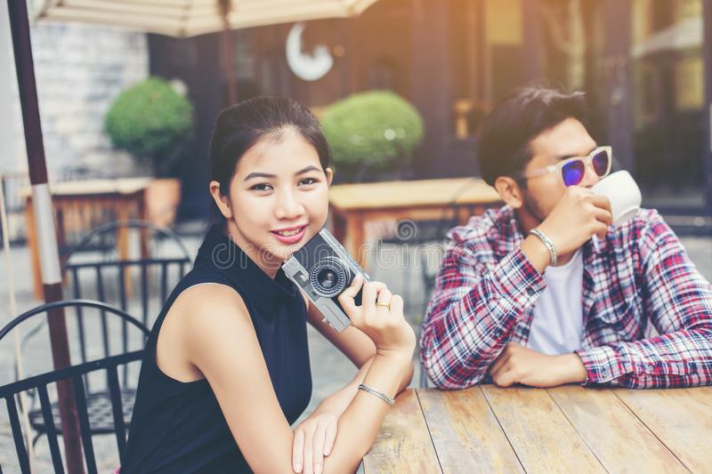 Group of young hipster sitting in a cafe,Young cheerful friends having fun while take time together, Holiday freedom enjoy royalty free stock image