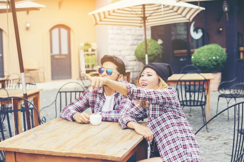 Group of young hipster sitting in a cafe,Young cheerful friends having fun while take time together, Holiday freedom enjoy stock image