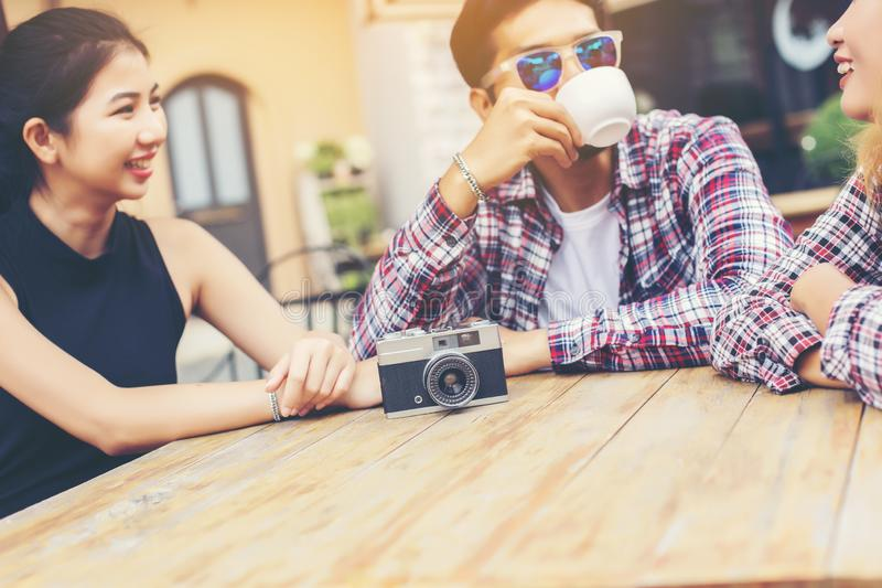Group of young hipster sitting in a cafe,Young cheerful friends having fun while take time together, Holiday freedom enjoy stock photography