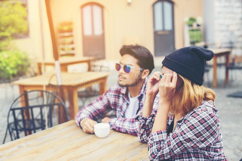 Group of young hipster sitting in a cafe,Young cheerful friends having fun while take time together, Holiday freedom enjoy royalty free stock images