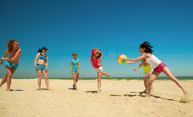 Download Group Of Young Joyful Girls Playing Volleyball Stock Photo - Image: 19793114