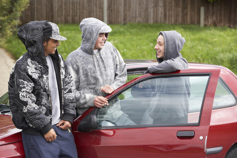 Group Of Young Men With Cars royalty free stock photography