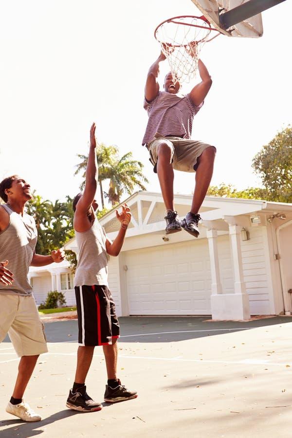 Group Of Young Men Playing Basketball Match stock photos
