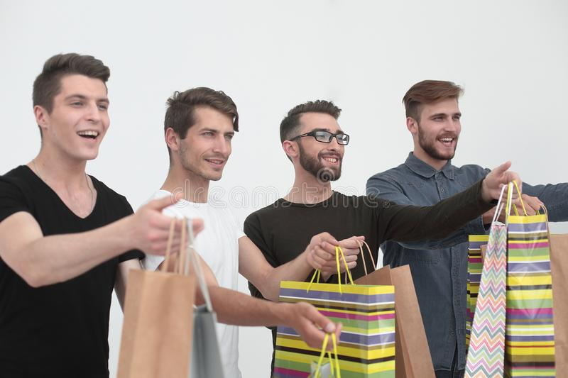 Group of young men with shopping bags stock photography