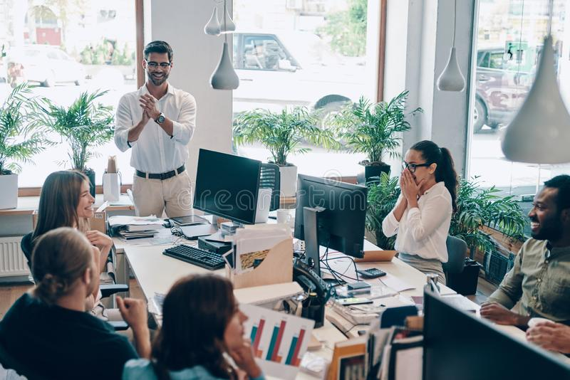 Group of young modern people in smart casual wear royalty free stock images