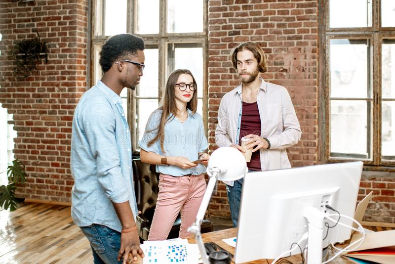 Coworkers talking together at the office stock photos