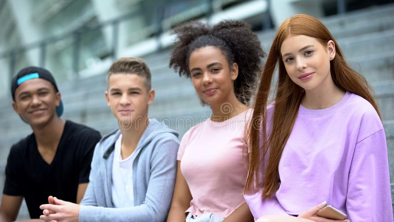 Group young multiethnic students looking camera outdoors, high school classmates royalty free stock photo