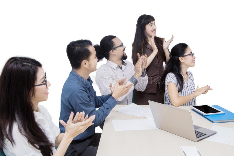 Multiracial business team applauding in office royalty free stock photo