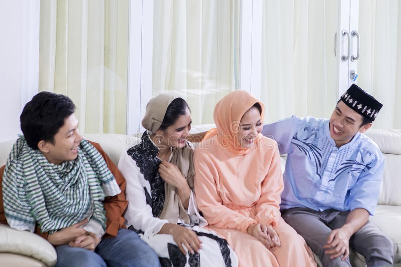 Happy Muslim people talk each other on the couch stock photos