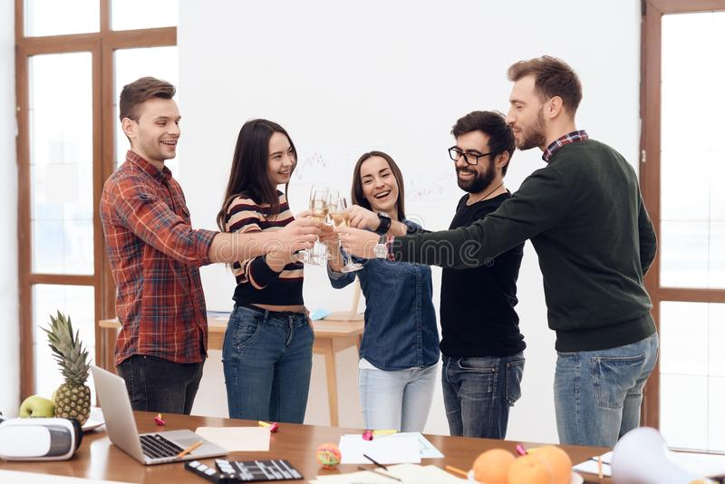 A group of young office workers celebrating. stock images