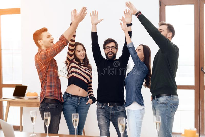 A group of young office workers celebrating. stock photo