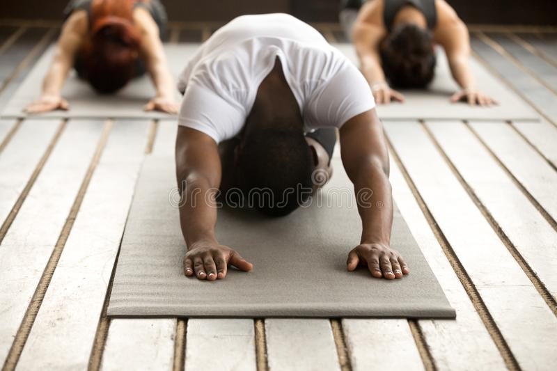 Group of young people in Balasana exercise stock photos