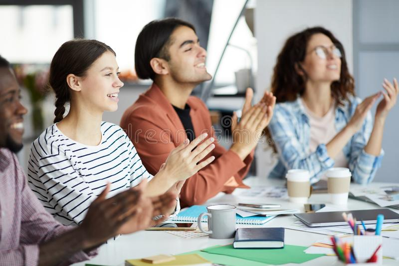 Young People Clapping for Presentation royalty free stock photos