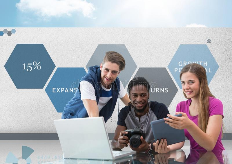 Group of young people on computer with camera in front of business graphics stock images
