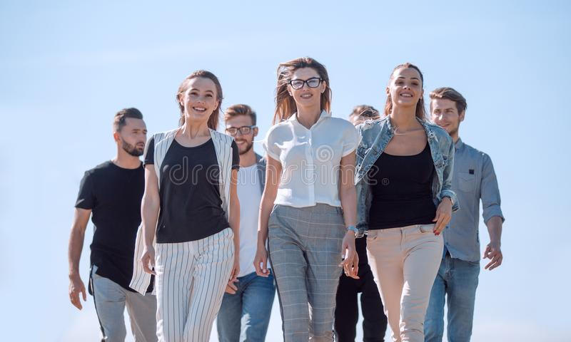 Group of young people, confidently stepping forward royalty free stock image