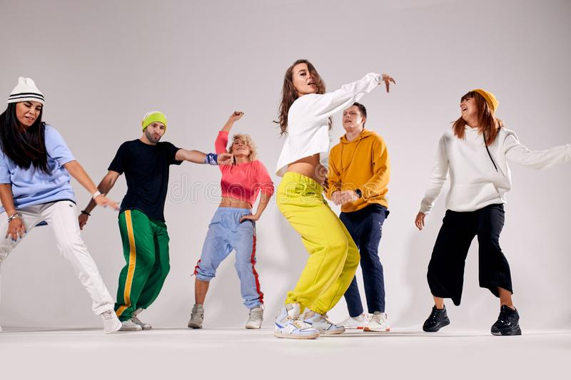 Group of young people dancing with pleasure royalty free stock photos