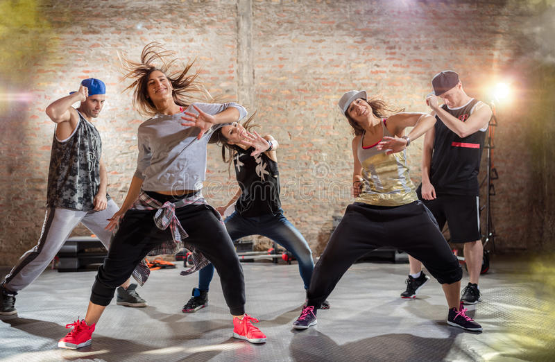 Group of young people dancing royalty free stock photo