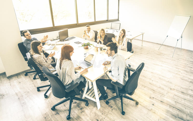 Group of young people employee coworkers at business meeting. In urban coworking place studio - Human resources concept at working time - Start up entrepreneurs stock images