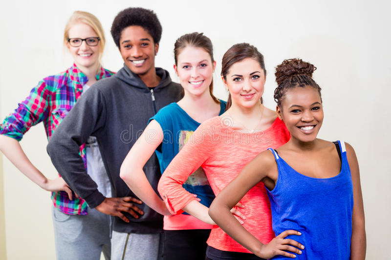 Group of young people having dance lessons stock images