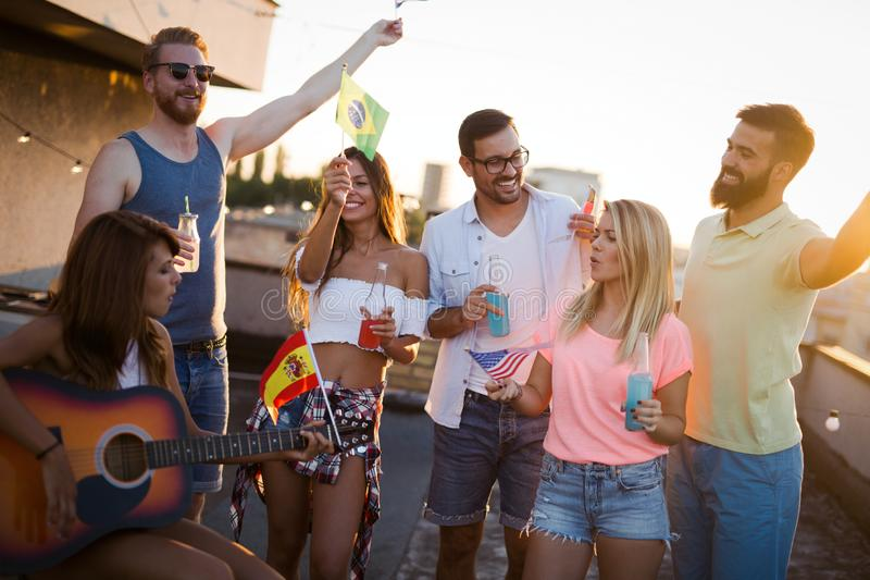 Group of young people having fun at a summertime party, at sunset royalty free stock photos