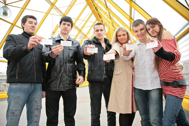 Group of young people hold blank cards royalty free stock images