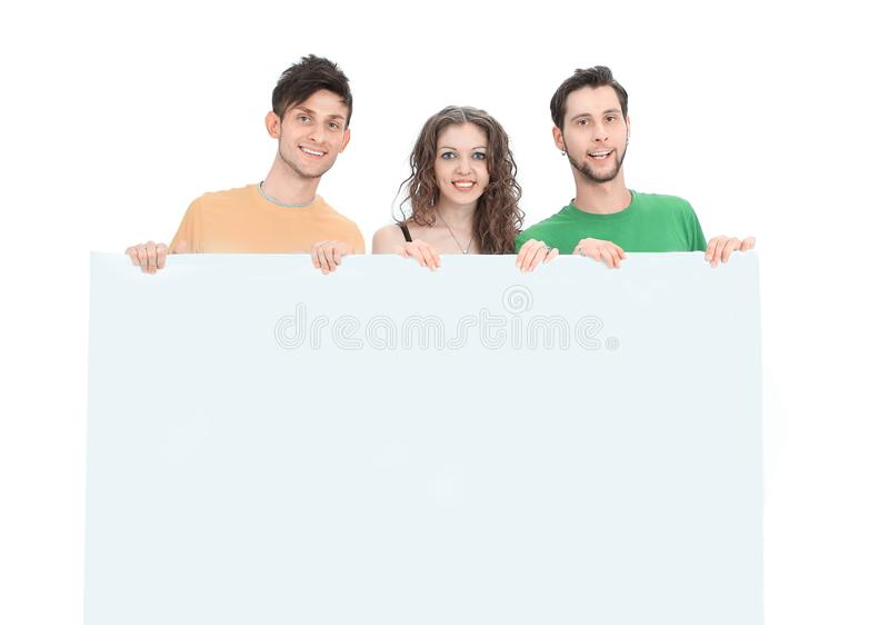 Group of young people holding a large blank poster. Isolated on a white background stock photography