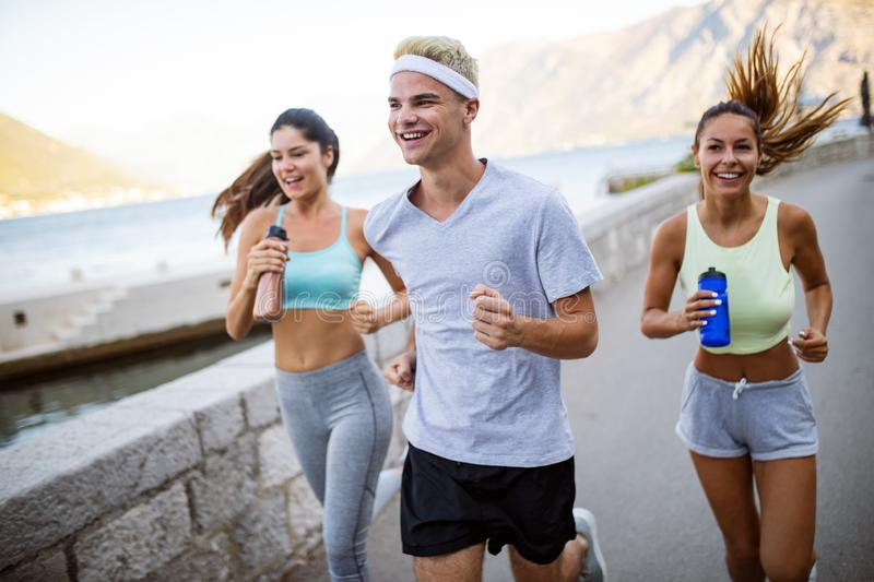 Group of young people jogging and running outdoors in nature stock photography