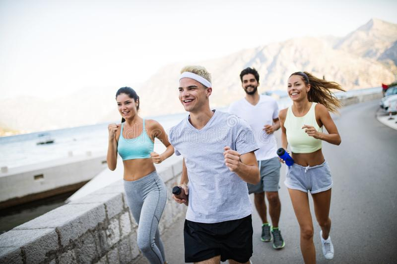 Group of young people jogging and running outdoors in nature royalty free stock images