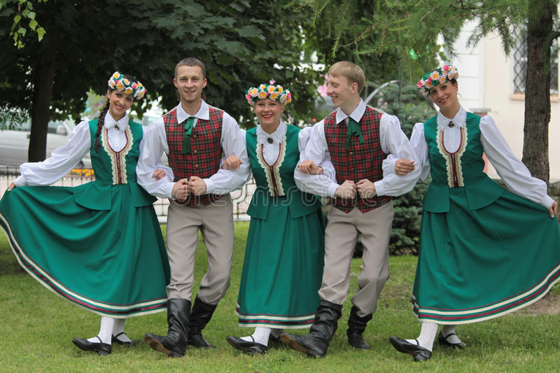 A group of young people of Latvian folk costumes stock image