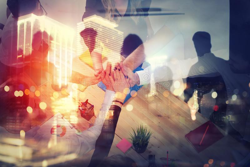 Handshaking business person in office. concept of teamwork and partnership. double exposure with light effects. Group of young people make an agreement in the vector illustration