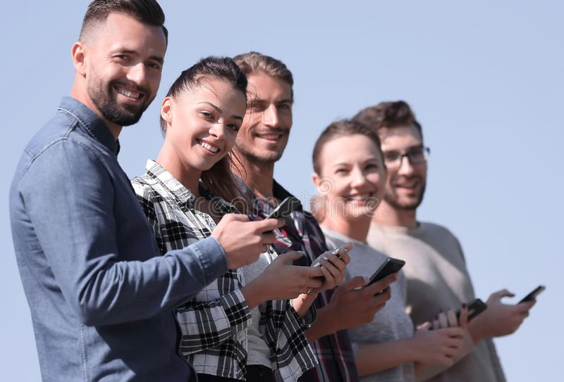 Group of young people with modern smartphones. royalty free stock photography
