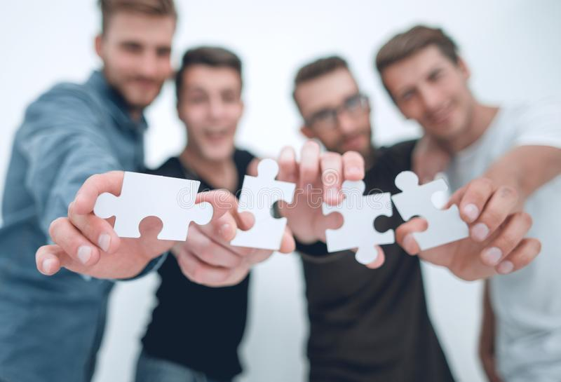 Group of young people with puzzle pieces stock image