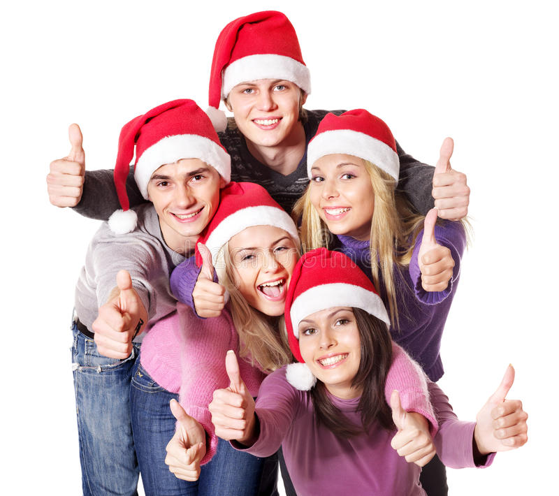 Group young people in santa hat show thumbs up. royalty free stock images