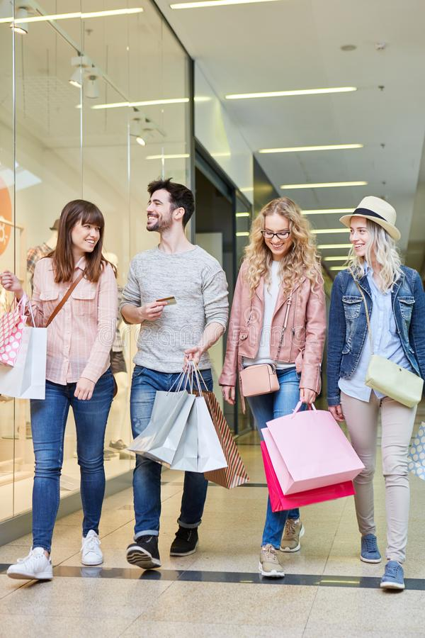 Group of young people is shopping stock photography