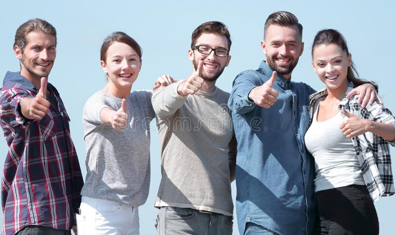 Group of young people showing thumb up royalty free stock photos
