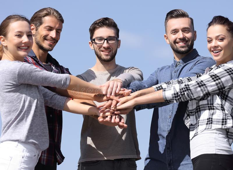 Group of young people shows their unity. stock photo