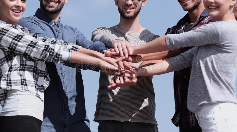 Group of young people shows their unity. Photo with copy space royalty free stock photo