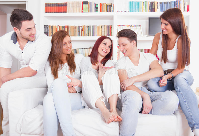 Group of young people smiling on the couch stock photos