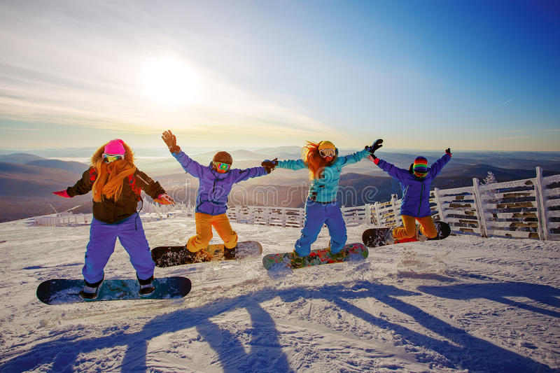 Group of young people with snowboard. On ski holiday in mountains stock photo