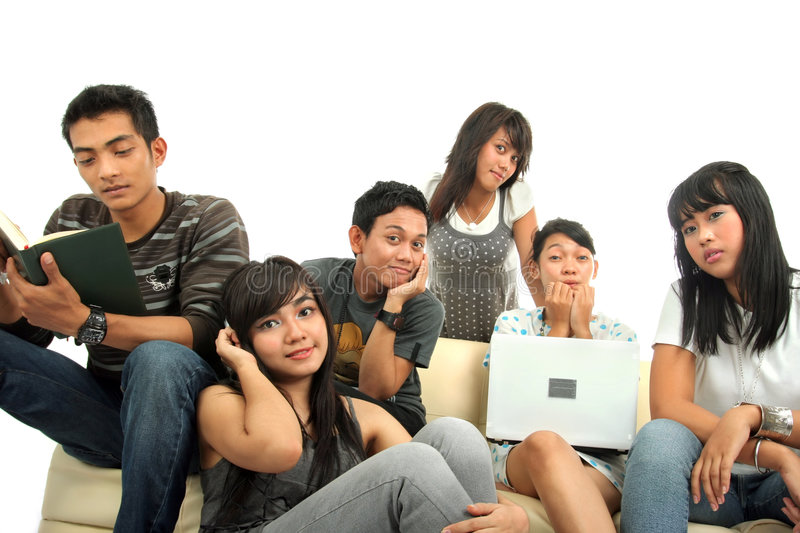 Group of young people on sofa stock photo