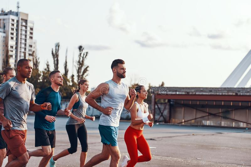 Group of young people in sports clothing royalty free stock photography