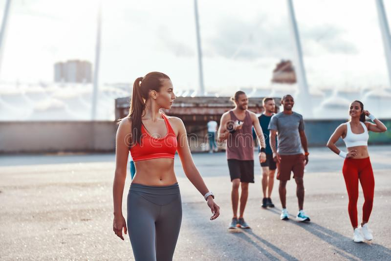 Group of young people in sports clothing royalty free stock image